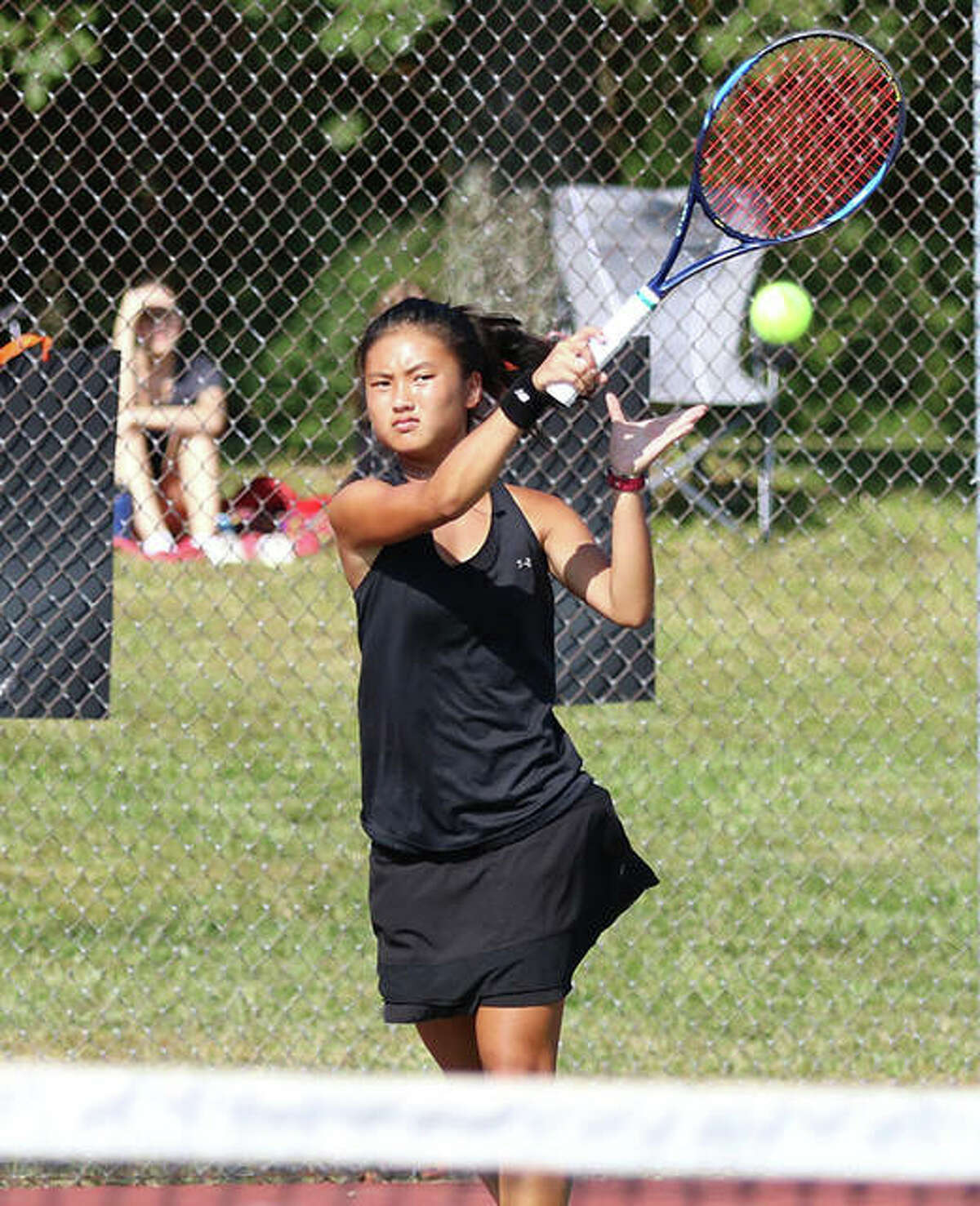 Edwardsville's Chloe Koons hits a shot a match last season at Edwardsville. Koons finished the season as a SWC and Class 2A sectional singles champion with a 34-0 record.