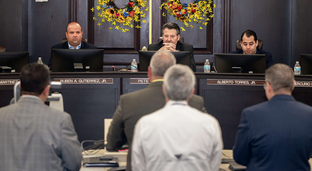 Laredo City Councilmember Ruben Gutierrez Jr., Mayor Pete Saenz and Councilmember Alberto Torres Jr. listen as Utilities Director Arturo Garcia, Assistant Utilities Director Michael Rodgers and TCEQ representatives detail the water treatment plant processes and distribution limits, Monday, July 12, 2021, during a special city council meeting at City Hall.