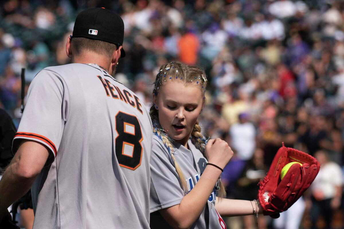 DENVER, COLORADO - JULY 11: Former MLB outfielder Hunter Pence bumps arms with Media Personality JoJo Siwa during the MLB All-Star Celebrity Softball Game at Coors Field on July 11, 2021 in Denver, Colorado. (Photo by Tom Cooper/Getty Images)
