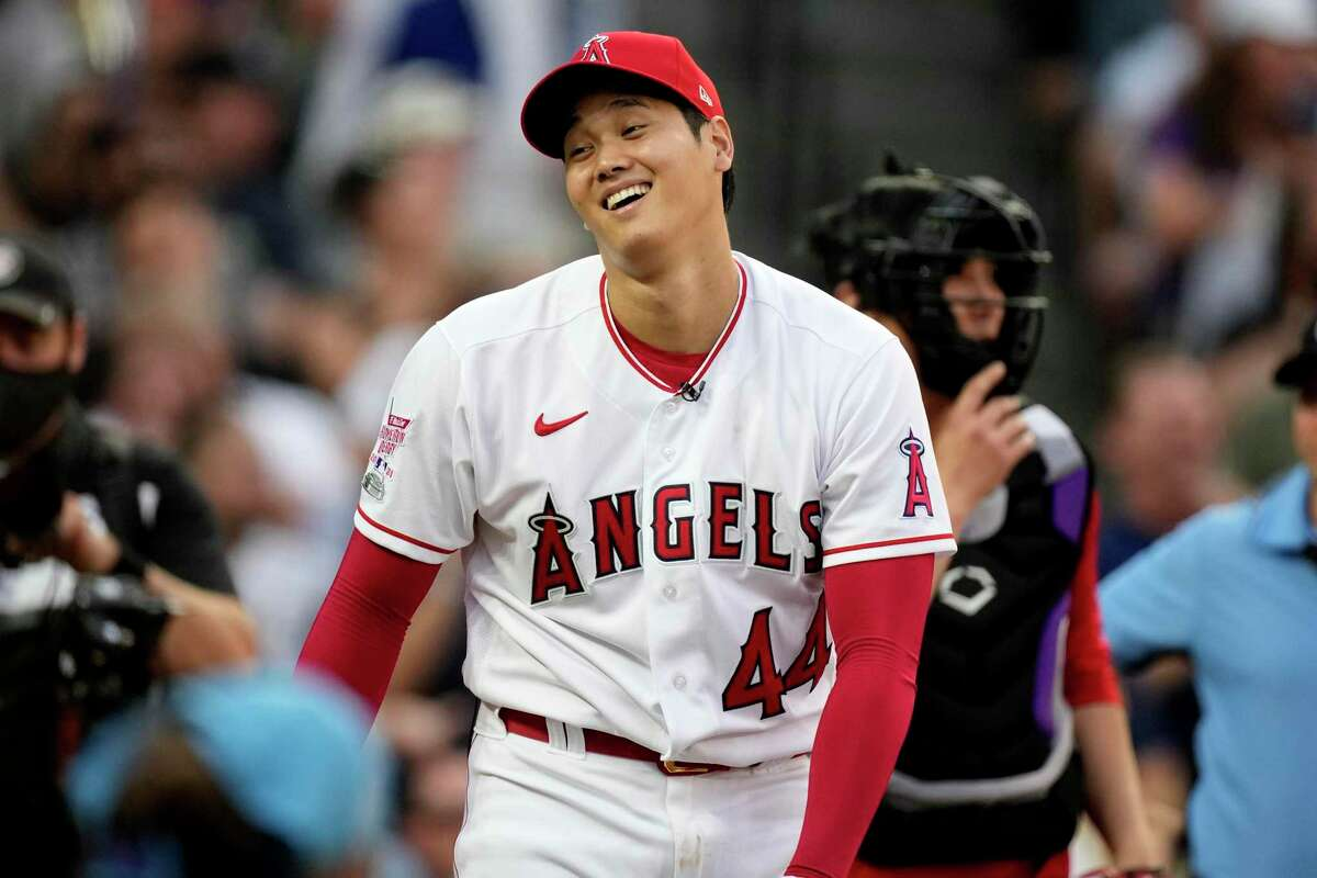American League's Shohei Ohtani, of the Los Angeles Angeles, reacts after the first round of the MLB All Star baseball Home Run Derby, Monday, July 12, 2021, in Denver. (AP Photo/David Zalubowski)