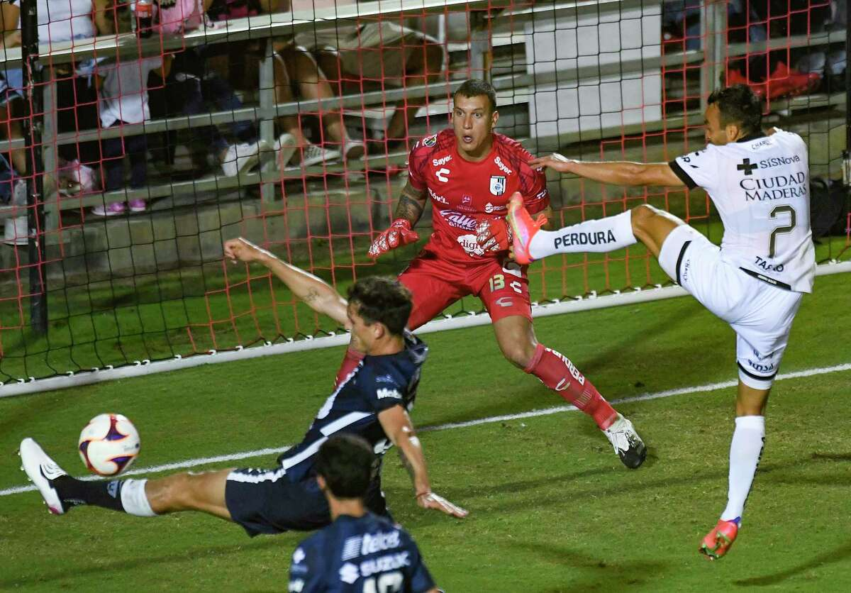 Queretaro FC goalkeeper Washington Aguerre, middle, and teammate Omar Mendoza, (2) successfully defend against a shot on goal by Juan Dinenno of Pumas UNAM during a friendly match at Toyota Field on Monday, July 12, 2021. The match, part of the San Antonio FC International Showcase, ended in a 2-2 tie.