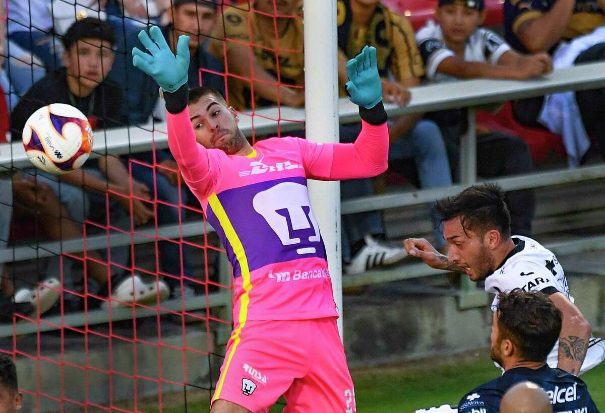 Pumas UNAM goalkeeper Julio Gonzalez is unable to stop by a goal by Maximiliano Perg, right, of Queretaro FC during a friendly match at Toyota Field on Monday, July 12, 2021. The match, part of the San Antonio FC International Showcase, ended in a 2-2 tie.