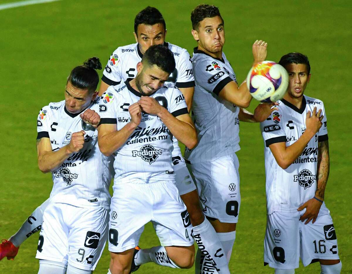 Queretaro FC players defend against a free kick against Pumas UNAM during a friendly match at Toyota Field on Monday, July 12, 2021. The match, part of the San Antonio FC International Showcase, ended in a 2-2 tie.