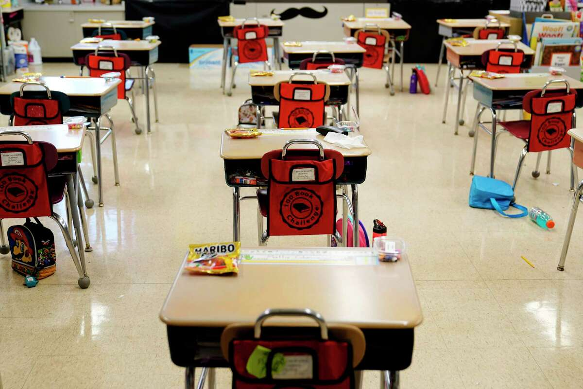 FILE - In this Thursday, March 11, 2021 file photo, desks are arranged in a classroom at an elementary school in Nesquehoning, Pa.