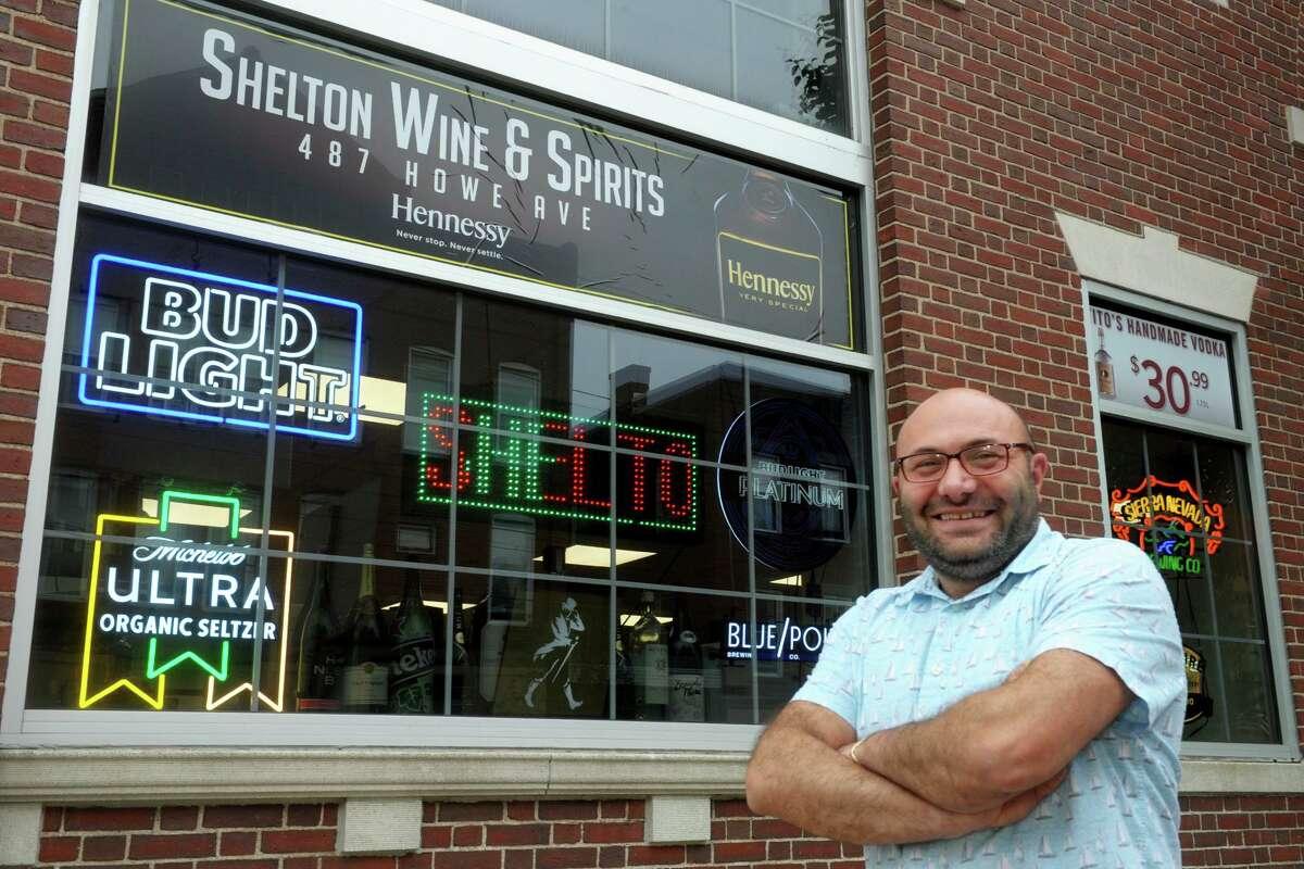 Owner Hagop Jarttian in front of Shelton Wine & Spirits on Thursday.