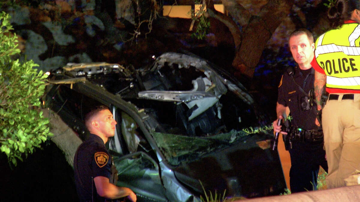 Three people were killed and one hospitalized after a car rolled off of a Northwest Side road early Tuesday morning.