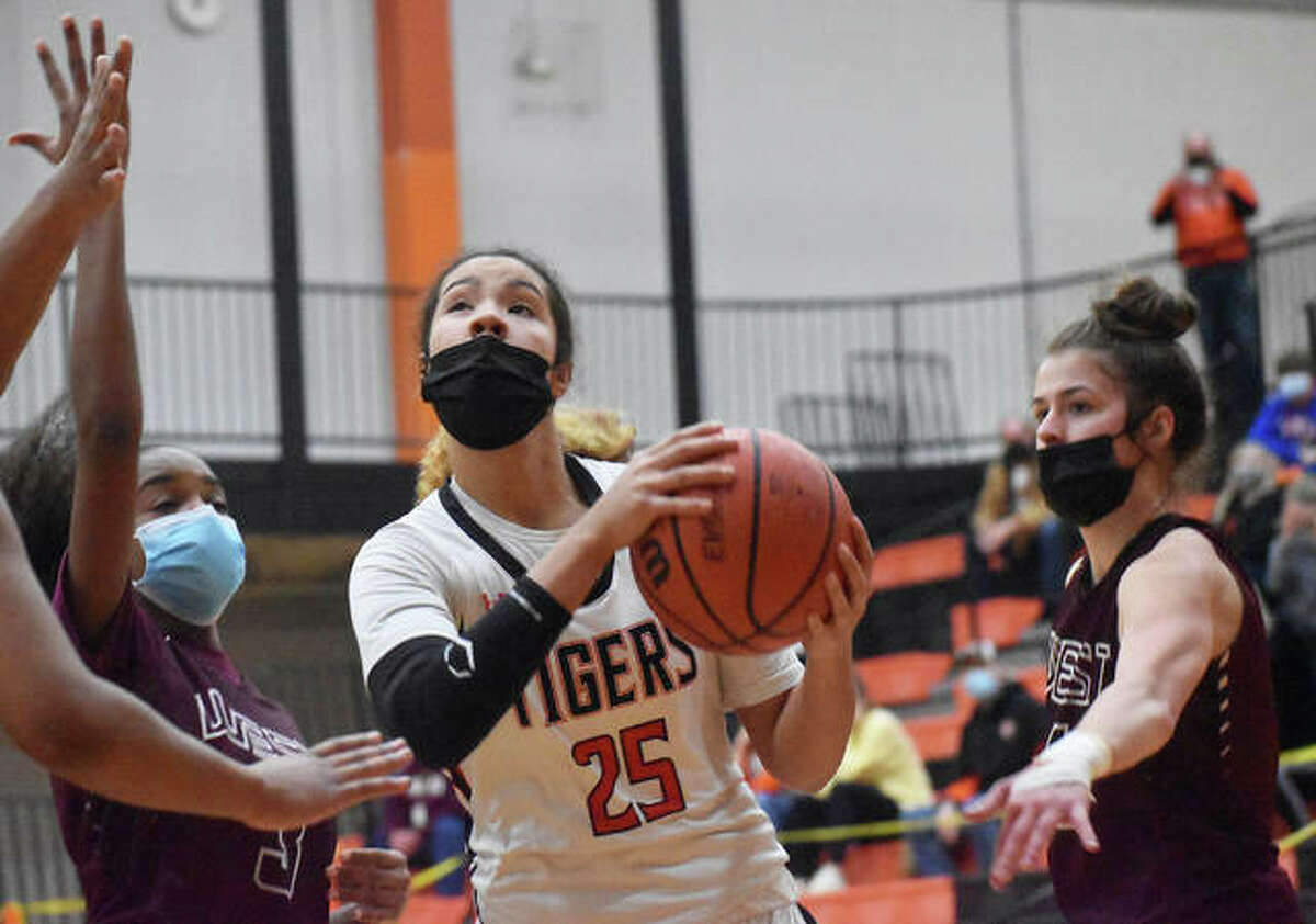 Edwardsville junior Sydney Harris eyes the basket as she splits the Belleville West defense in the first quarter of the season opener inside Lucco-Jackson Gymnasium.