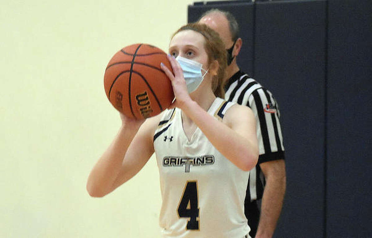 Father McGivney senior guard Anna McKee puts up a 3-pointer from the corner during a home game against Granite City.