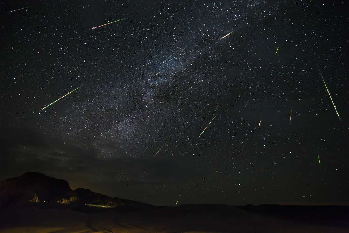 Meteors of the Perseid Meteor Shower are seen as they dart across the night sky on Aug. 14, 2016 in Terlingua, Texas.
