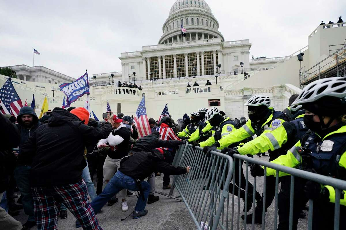 In this Jan. 6, 2021 file photo, supporters loyal to then-President Donald Trump, try to break through a police barrier at the Capitol in Washington. The FBI is searching for a Mill Valley man suspected of taking part in the January 6 riot at the U.S. Capitol.