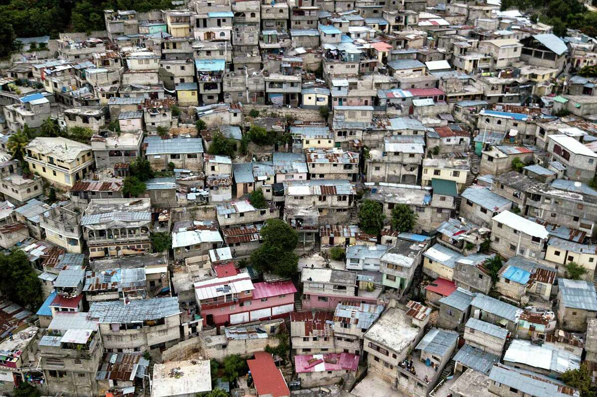 Homes at the Bois Patate neighborhood are crowded together in Port-au-Prince, Haiti, Monday, July 12, 2021. (AP Photo/Matias Delacroix)