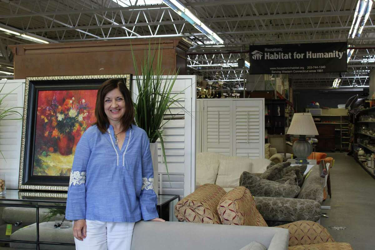 Ridgefield resident Diana Arfine was recently named the new executive director of Housatonic Habitat for Humanity after serving as the organization's ReStore manager during the pandemic. Pictured is Arfine at the facility, which she styled to emulate a furniture showroom - a trick she picked up while volunteering at the Ridgefield Thrift Shop.