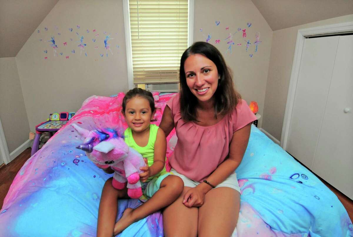 Danielle Cartolano and her daughter Isabella, 4, pose at their home in Greenwich, Conn., on Friday July 9, 2021. Cartolano participated in Family Centers' Parents as Teachers program.