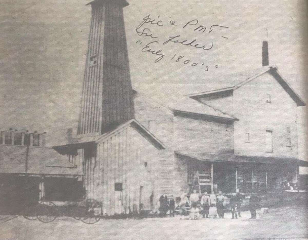 This grist mill in 1890 was opposite the Ray Hart home on Main Street. It was rented by Herbert H. Dow. This mill was owned by Evans, Eesley and Harris. Dow began operations on a 24-hour basis with a three-man crew -- William Adres, the miller; Malcolm McDonald, the cooper, and John McDonald, the salt maker.