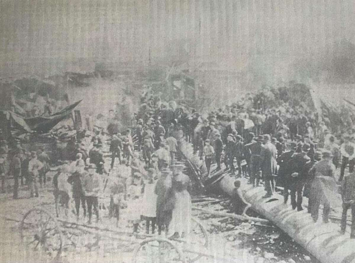 """Bedlam after the Midland mill explosion disaster in 1892. The mill was located at the foot of McDonald Street. A boiler explosion wrecked most of the mill. The tall chimney shown in the photo was razed by the blast and killed a workman in its fall. A flying piece of steel from the boilers near the chimney killed an """"edgerman"""" in the mill."""