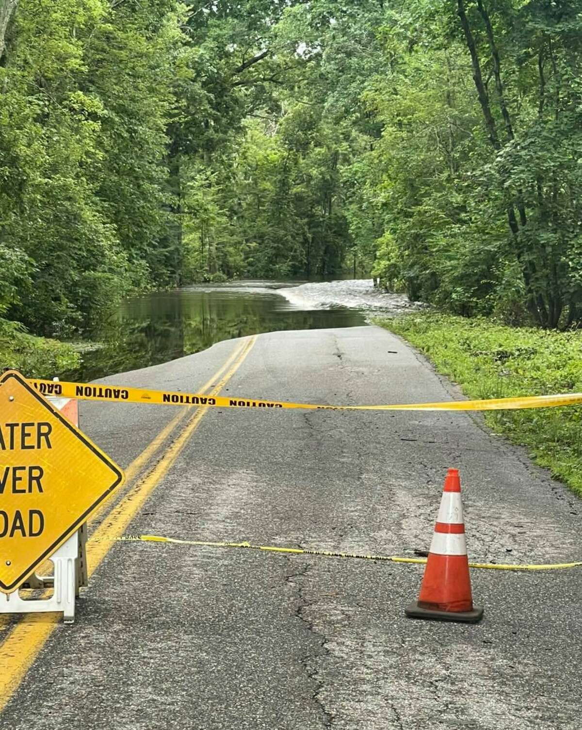 A flooded roadway in Columbia, Conn., after tropical storm Elsa plummeled the state on July 9, 2021.