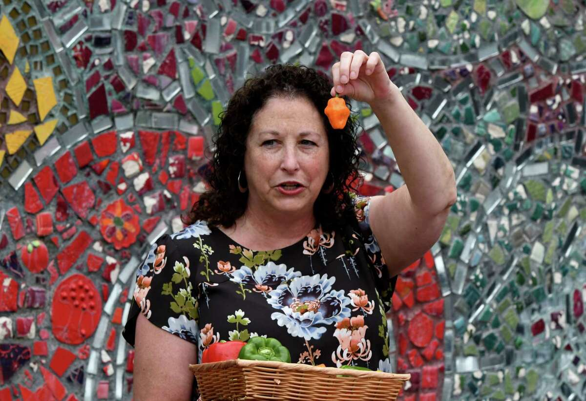 Amy Klein CEO, Capital Roots, hold up one of the hot peppers offered to participants in the Capital Roots Hot Pepper Challenge to raise awareness of healthy food access in communities on Tuesday, July 13, 2021, at Capital Roots Urban Grow Center in Troy, N.Y. (Will Waldron/Times Union)