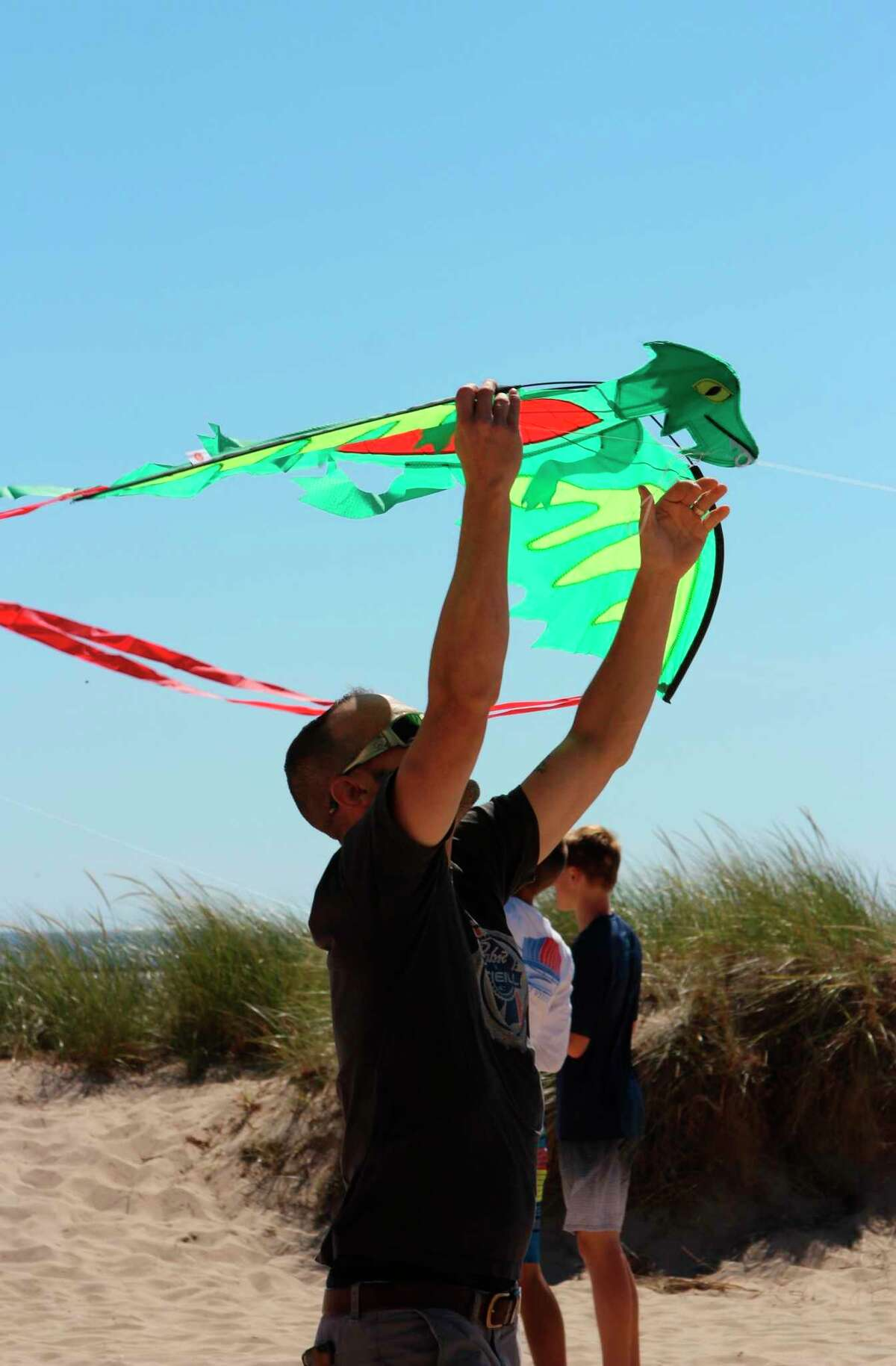 """""""Lets go Fly a Kite"""" events at the Lake Michigan beach in Frankfort are a great place for people to fly kites with others, as well as get a complimentary kite. (File Photo)"""