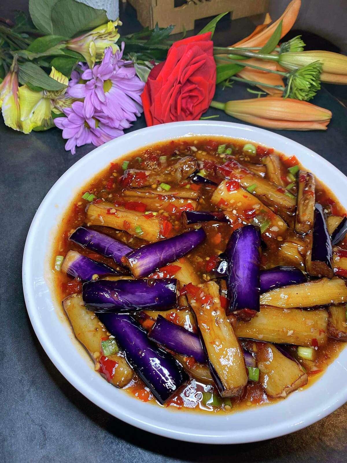 Spicy garlic eggplant is a colorful stir-fry at Dashi Sichuan Kitchen + Bar.