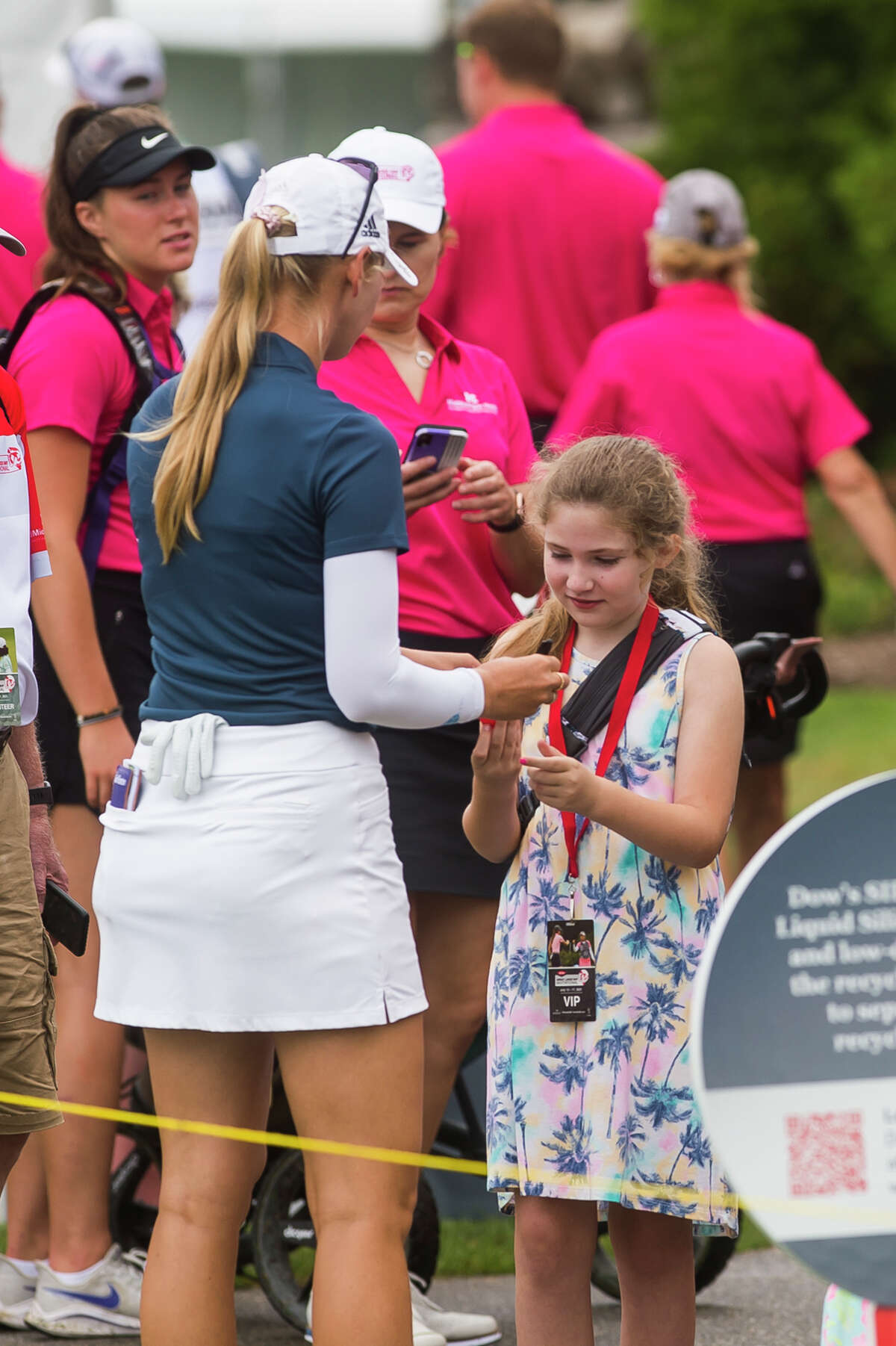 LPGA player Jessica Korda signs an autograph for a fan during the Dow Great Lakes Bay Invitational Pro Am tournament Tuesday, July 13, 2021 at the Midland Country Club. (Katy Kildee/kkildee@mdn.net)