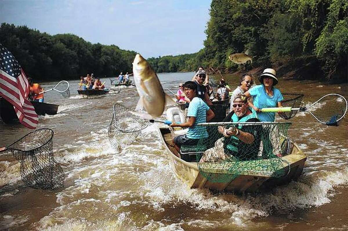 Fishing poles are not allowed for the Redneck Fishing Tournament. Instead, teams are scored based on how many Asian carp they can pluck from the air with nets or that land in their boats. The fish jump from the water when startled.