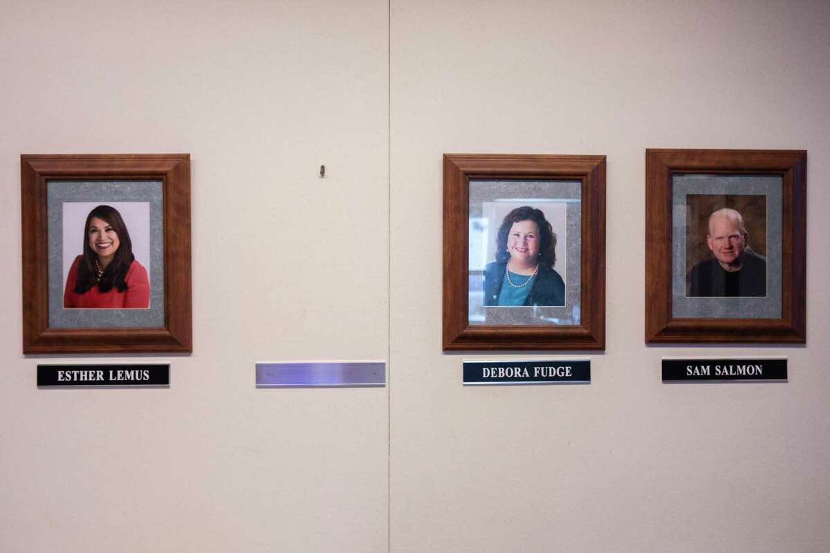 A blank space where former Windsor Mayor Dominic Foppoli's portrait once hung in the town hall is seen on June 2 between other images of Windsor council members during the first in-person Town Council meeting since the pandemic begun.