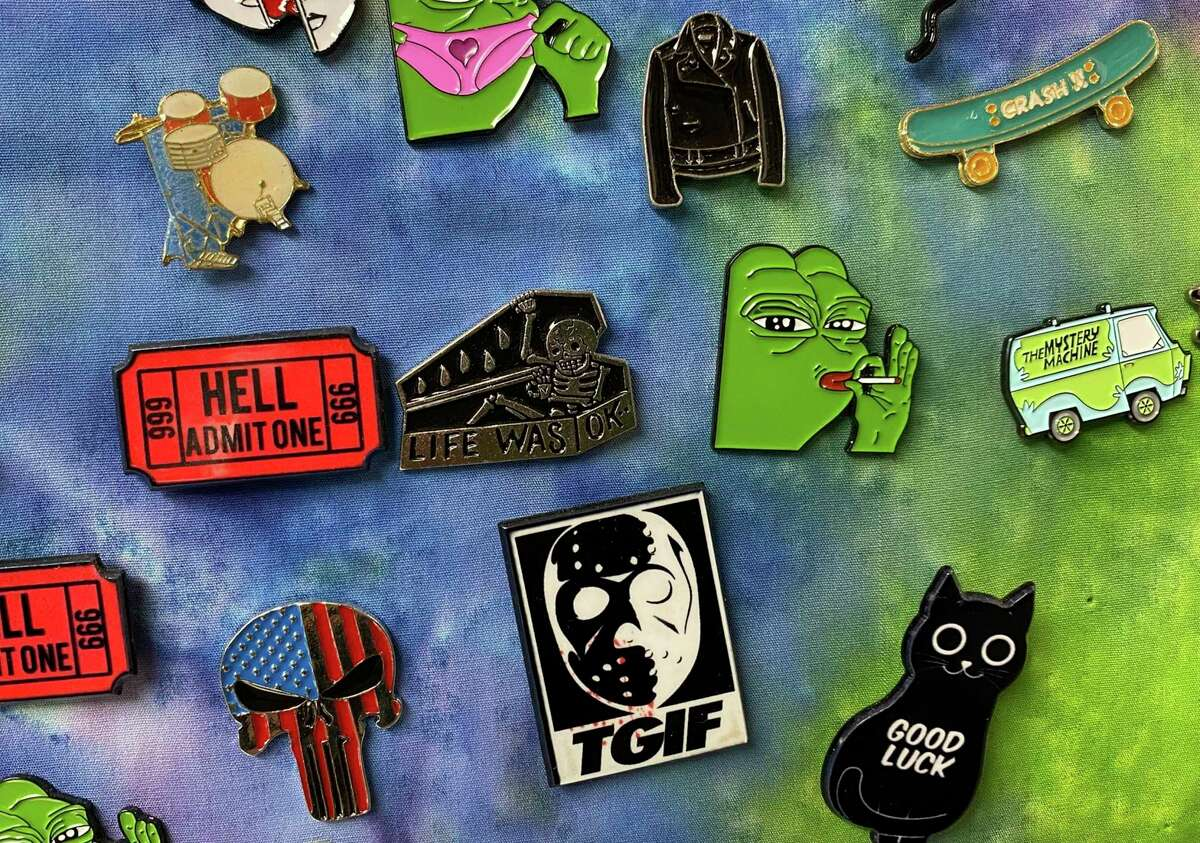 Novelty pins are among the numerous items available at Happy Daze Smoke-N-More in Bad Axe. (Mark Birdsall/Huron Daily Tribune)