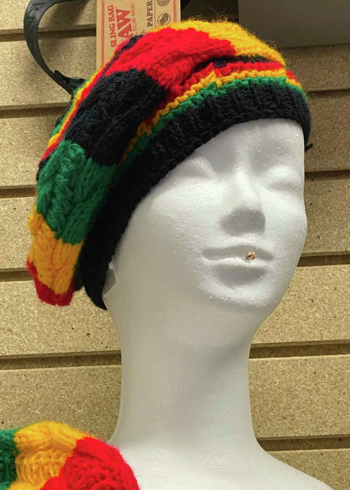 A Rastafarian-style hat sits on a mannequin head in Happy Daze Smoke-N-More in Bad Axe. (Mark Birdsall/Huron Daily Tribune)