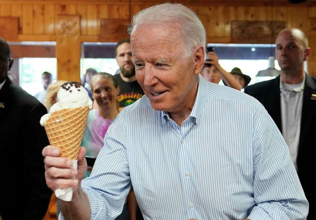 President Joe Biden holds an ice cream cone as he visits Moomers Homemade Ice Cream, Saturday, July 3, 2021, in Traverse City, Mich. (AP Photo/Alex Brandon)