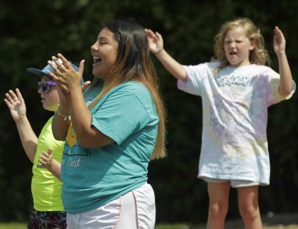 Jaylene Acosta cheers as Conroe police officers play a game of dodgeball against counselors from the Oscar Johnson, Jr. Community Center to build community relationships, Tuesday, July 13, 2021, in Conroe. Photo: Jason Fochtman/Staff Photographer / 2021 ? Houston Chronicle