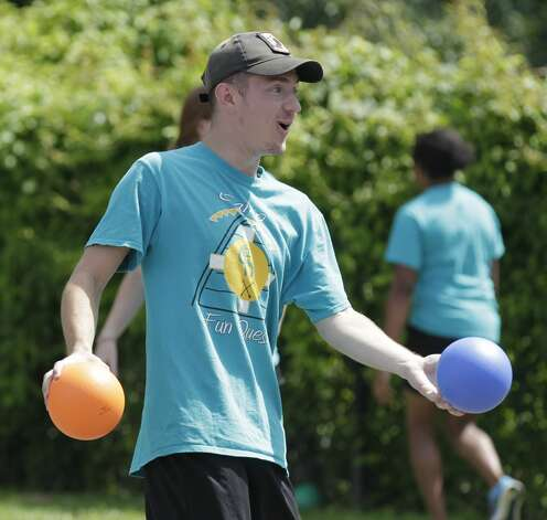 Kyle Blunk reacts after dodging a ball during a game of dodgeball against members of the Conroe Police Department at the Oscar Johnson, Jr. Community Center, Tuesday, July 13, 2021, in Conroe. Photo: Jason Fochtman/Staff Photographer / 2021 © Houston Chronicle