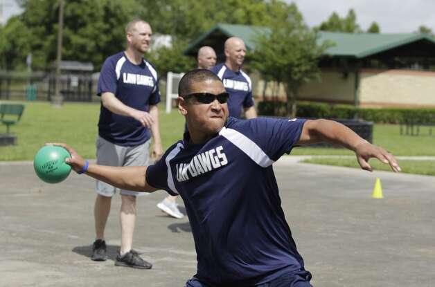Conroe Police Officer Richard Cruz throws a ball during a game of dodgeball against counselors from the Oscar Johnson, Jr. Community Center to build community relationships, Tuesday, July 13, 2021, in Conroe. Photo: Jason Fochtman/Staff Photographer / 2021 ? Houston Chronicle
