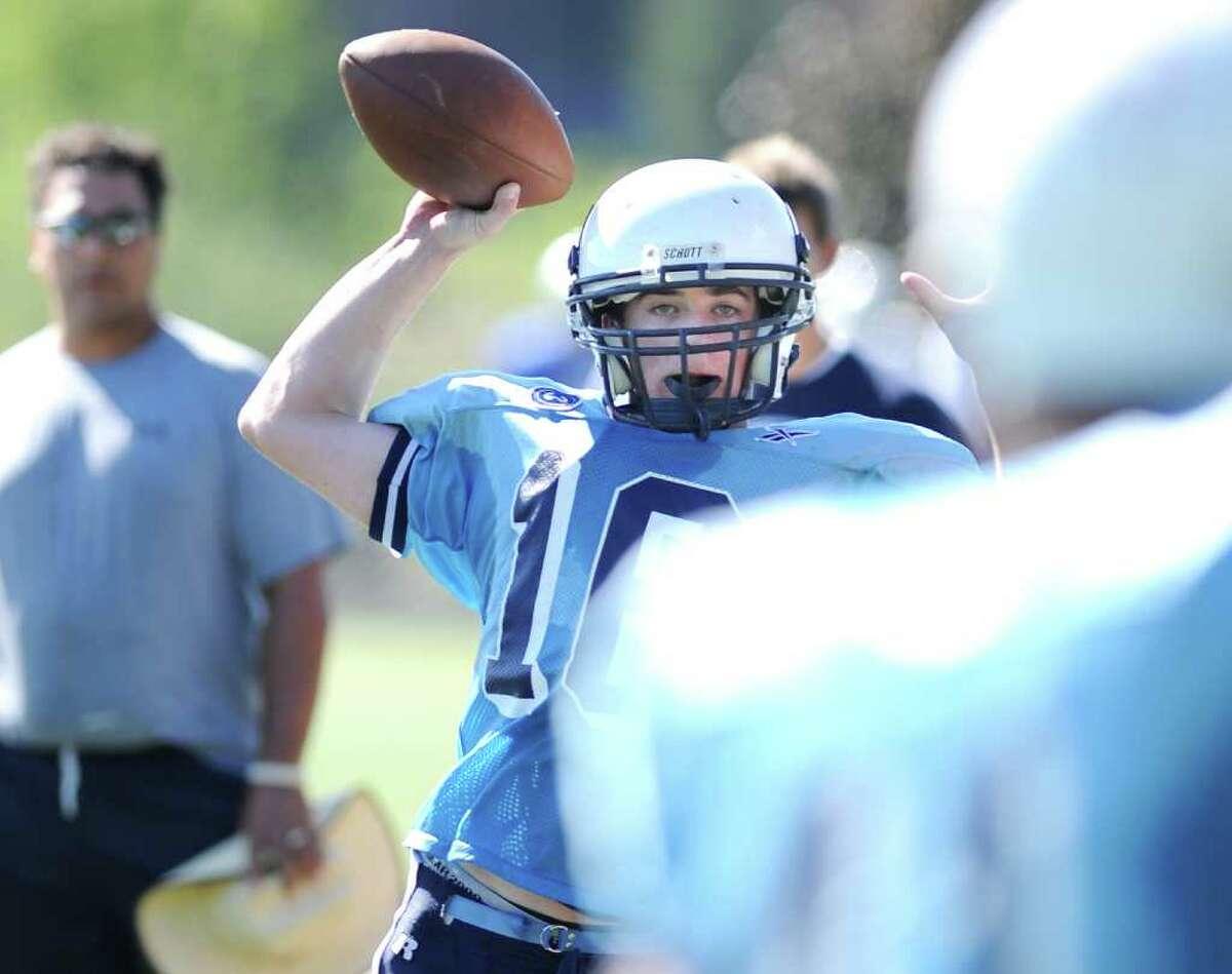 Wilton High School football quarterback Sean Carroll throws during football jamboree at Wilton High School, Saturday morning, Sept. 4, 2010.