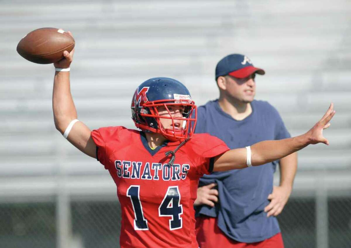 Brien McMahon High School football quarterback, Damien Vega, throws during practice at the school, Tuesday afternoon, Sept. 7, 2010.