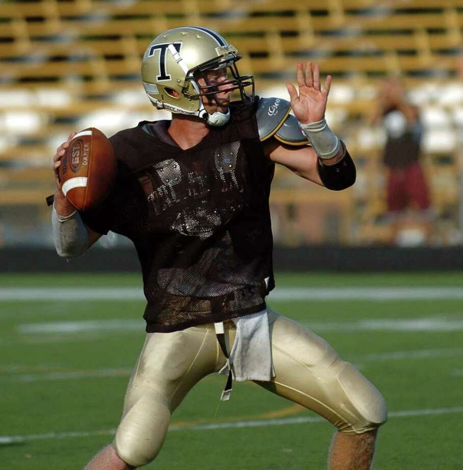 Trumbull's QB Ian Milne readies a pass during a football scrimage against Fairfield Prep in Trumbull, Conn. on Tuesday September 7, 2010. Photo: Christian Abraham, ST / Connecticut Post