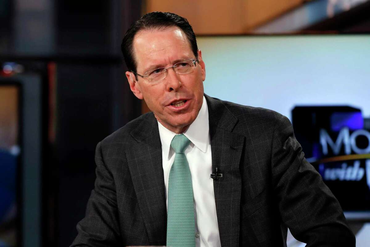 """FILE - In this Feb. 21, 2019 file photo, AT&T Chairman & CEO Randall Stephenson is interviewed by Maria Bartiromo during her """"Mornings with Maria Bartiromo"""" program on the Fox Business Network, in New York. Stephenson is stepping down after leading the telecommunications giant for 13 years. The Dallas company named John Stankey as chief executive effective July 1, 2020. Stankey, 57, has been president and chief operating officer since October 2019 (AP Photo/Richard Drew, File)"""