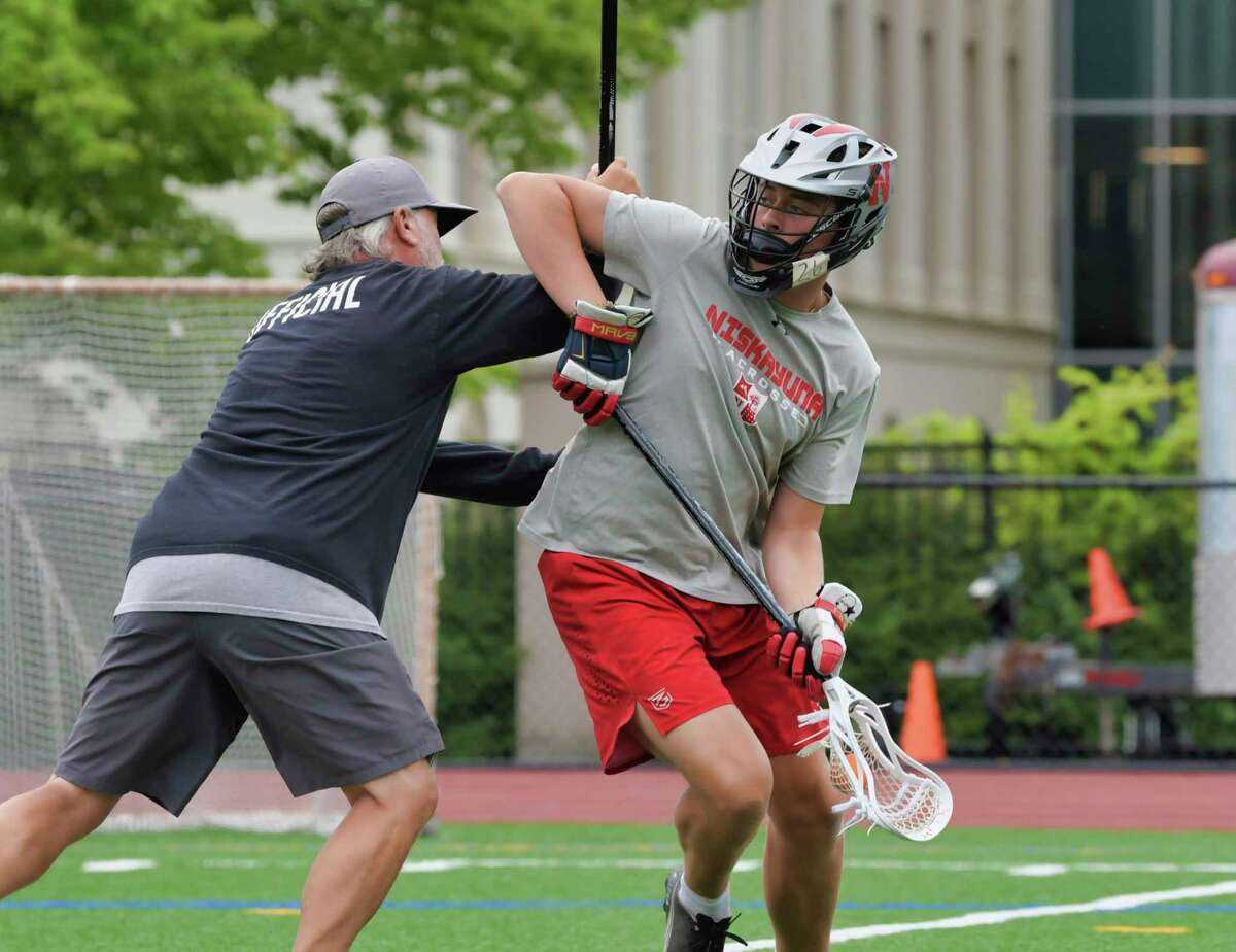 Niskayuna High School lacrosse player Grayson Vorgang, right, works on his dodging skills with his father, Mike Vorgang, at Union College on Tuesday, July 13, 2021. (Paul Buckowski/Times Union)