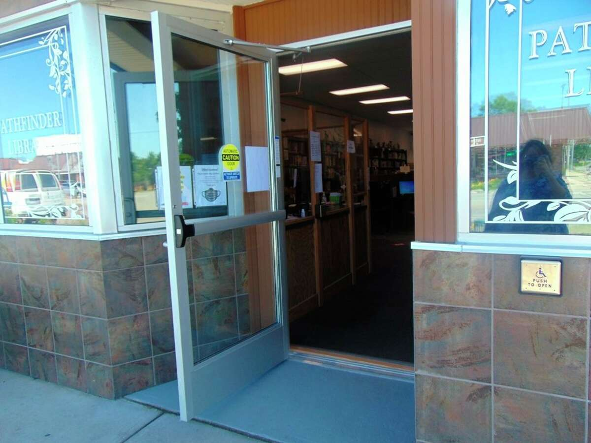 Patrons at the Pathfinder Community Library will have easier access to the library, thanks to the instillation of a new automatic door, made possible by two grants. (Star photo/Shanna Avery)