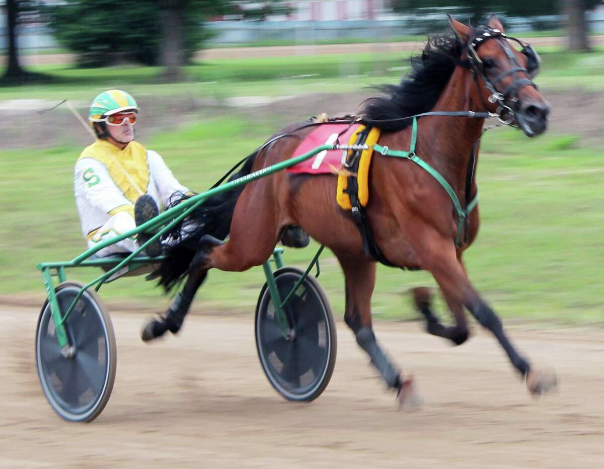 Smith and his colt prepare to hit the home stretch during Monday's harness race at the Mecosta County Fair. (Pioneer photo/Joe Judd)