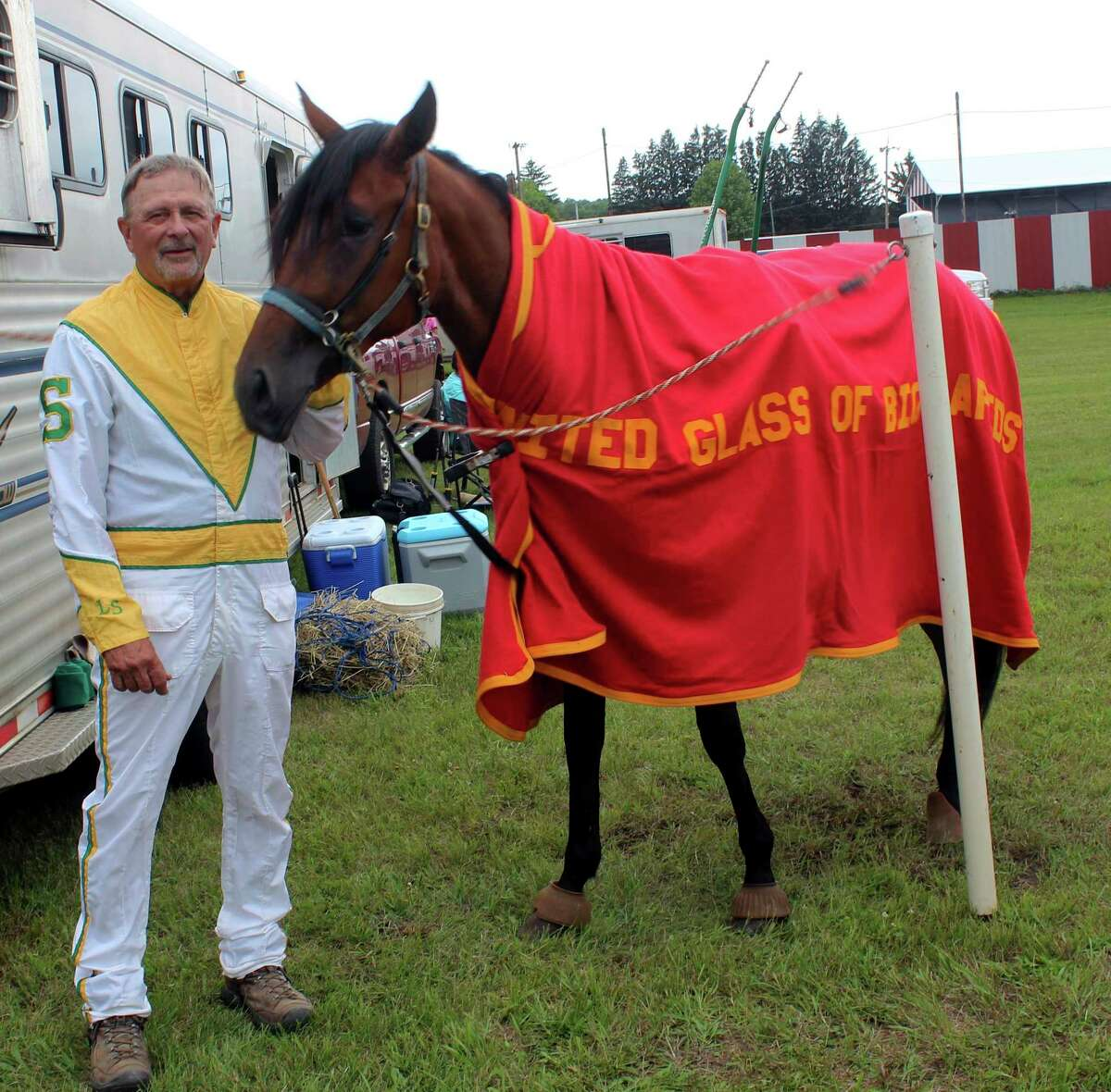 Longtime harness racer Larry Smith and his colt, Calmy Senorita,pose for a photo prior to Monday night's race. (Pioneer photo/Joe Judd)