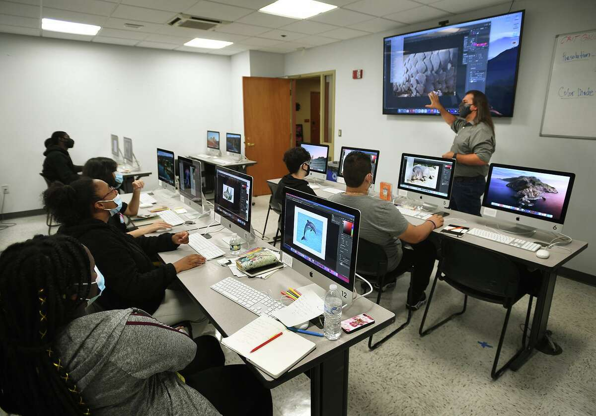 Instructor Mike Denysenko teaches Bridgeport high schoolers to use Photoshop to design a poster at the Summer Studio Discovering Graphic Design program at Sacred Heart University in Fairfield, Conn. on Tuesday, July 13, 2021.