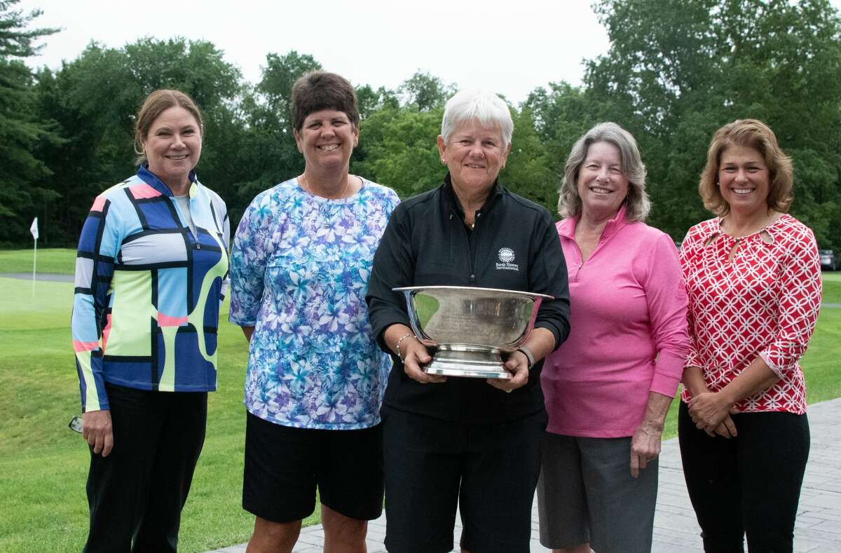 Northeastern Women's Golf Association board members, from left, Nancy Kroll, Peg Squazzo, President Donna Heskett, Kathy McLaughlin and Deb DiMaggio hold the NEWGA Founders Cup, discovered in a basement at McGregor Links in Wilton. The Cup was given to the organization at the NEWGA Team Play event at McGregor on July 7, 2021. (Joyce Bassett / Special to the Times Union)