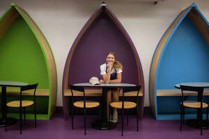Sarah Maschino poses for a portrait at a table in Great Lakes Ice Cream July 13, 2021