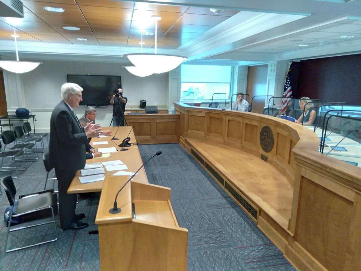 Attorney Christopher Hug (standing) arguing on behalf of Fotis Dulos' estate at probate Court in Farmington.