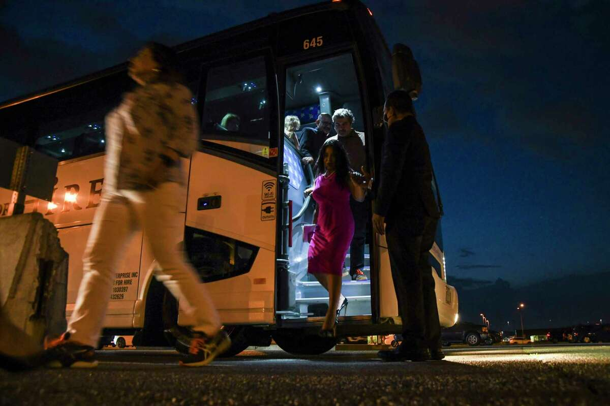 Texas House Democrats depart a bus at Dulles International Airport in Dulles, Va., after fleeing Texas in an effort to block the voting restrictions bill, Monday evening, July 12, 2021. They fled the state on Monday in a last-ditch effort to prevent the passage of a restrictive new voting law by the Republican-controlled Legislature, heading to Washington to draw national attention to their cause. (Kenny Holston/The New York Times)