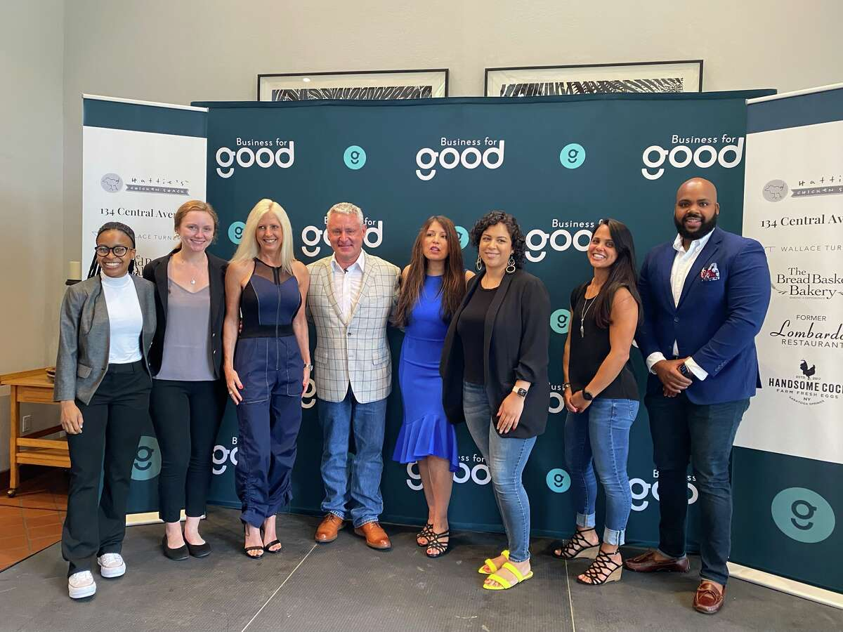 Staff of Business for Good at 605 N. Broadway, Saratoga Springs, July 13, 2021. L-R: Interns Mikea Bodden and Nayeli Selkis; founders Lisa and Ed Mitzen; Chief Brand Officer Connie Frances Avila, Officer Manager Alexa Andujar, Project Manager Stephanie Marotta-Johnson and CEO Jahkeen Hoke.