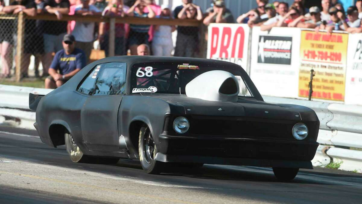 Dru Williams of Manton was quick and consistent with his Chevy Nova, celebrating his second championship of the season in Top Doorslammer. His three winning run elapsed times were 4.51, 4.52 and 4.51 at 159 miles per hour. (Courtesy photo)