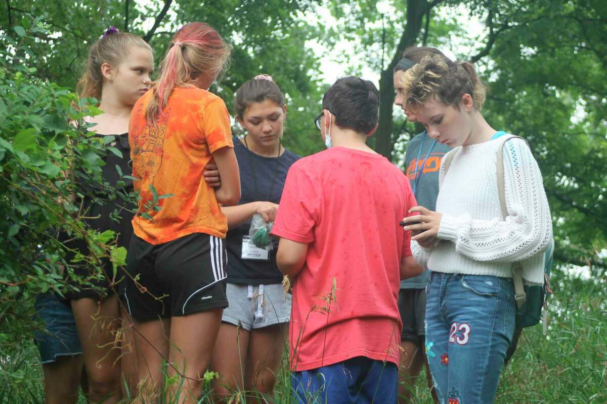 Erin Middleton, Armory Youth Project intern/volunteer, launched a geocaching program at the AYP to share one of her hobbies with the students. (Kyle Kotecki/News Advocate)