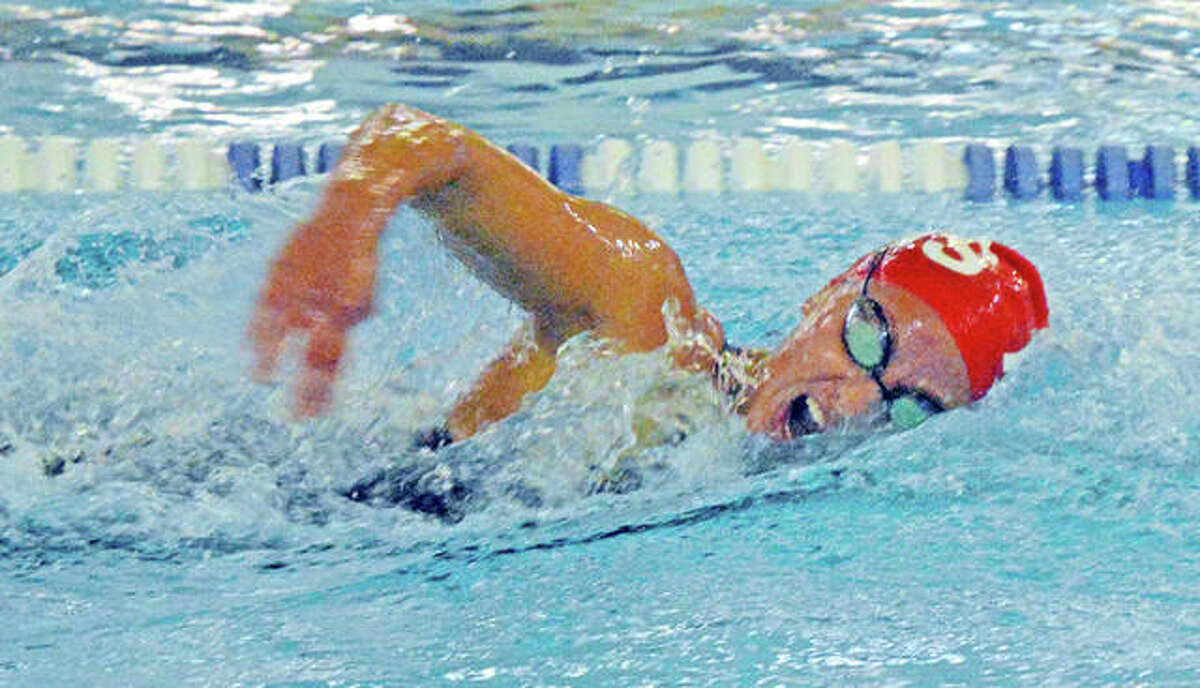 Eleni Kotzamanis of Alton High swim the 200-yard freestyle at last season's IHSA Girls Sectional meet at the Chuck Fruit Aquatic Center in Edwardsville. Kotzamanis was second in the event and was second in the 500-yard freestyle. She finished first in the 100-yard backstroke.
