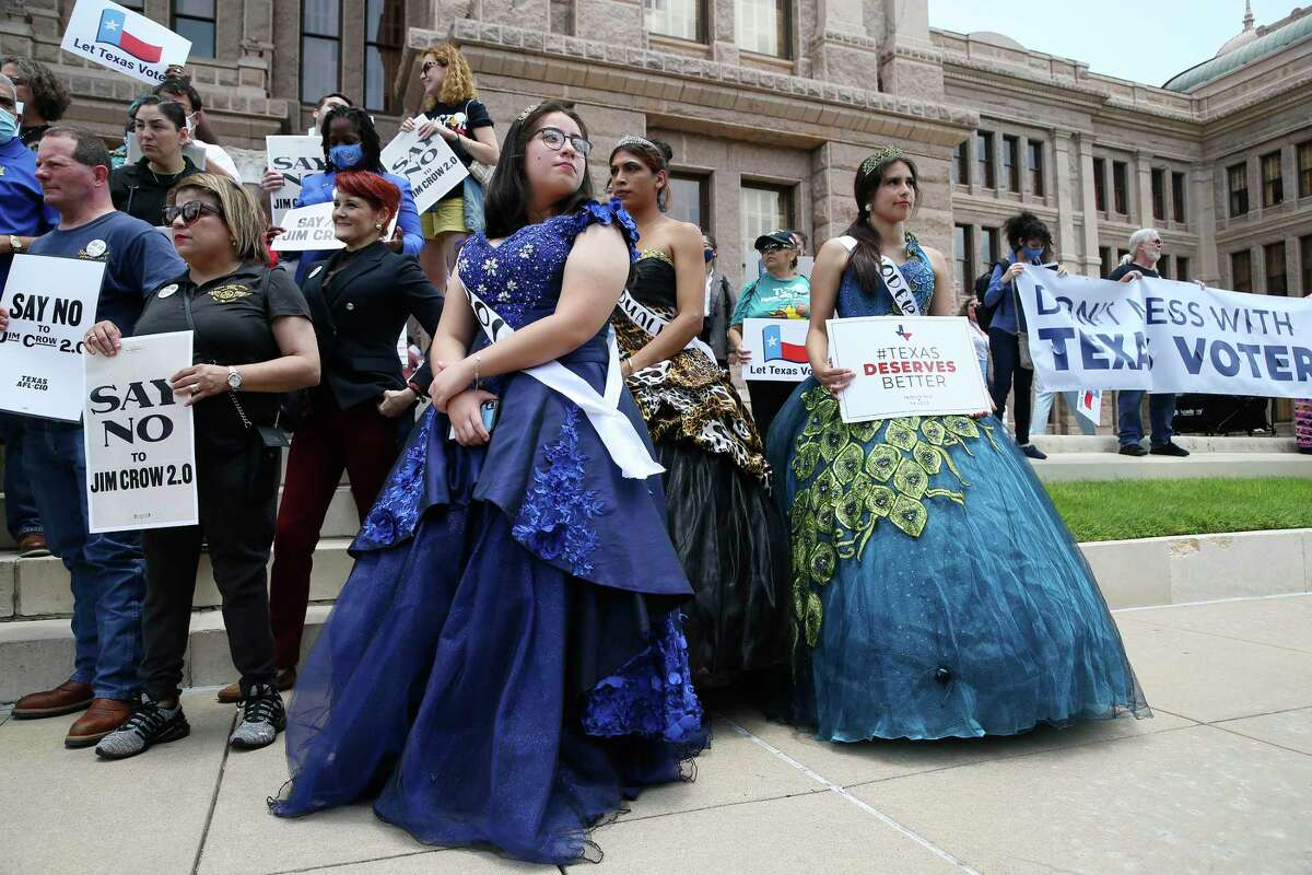 Women dressed in Quinceñeras gowns join in the Voting Rights Advocacy Day Rally at the State Capitol, Tuesday, July 13, 2021. Several hundred attended the rally. Later in the afternoon, the Texas House Republican caucus held a press conference.